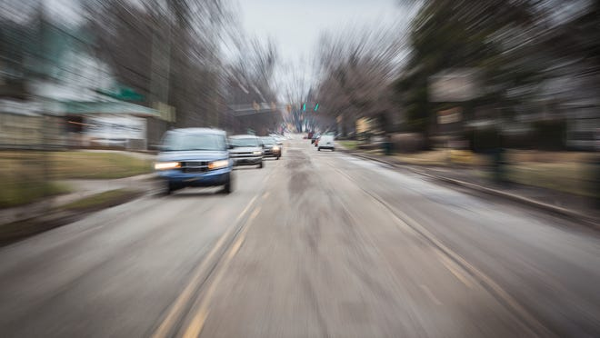 Traffic moves along a Muncie street in this file photo.