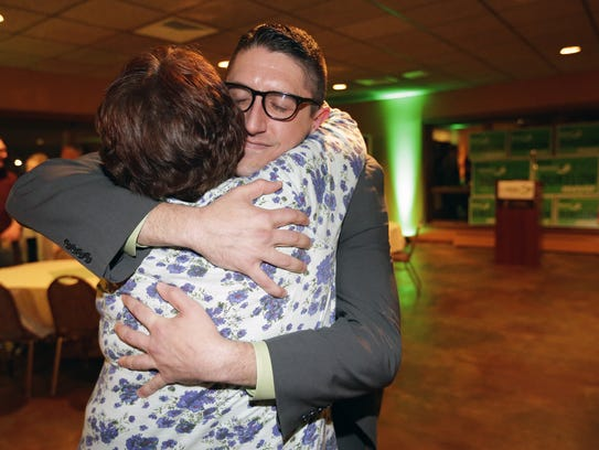 Appleton mayoral candidate Josh Dukelow gets a hug
