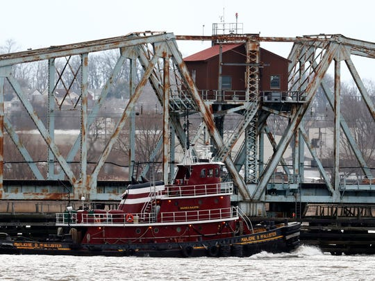 The tugboat Marjorie B. McAllister making its way on the Raritan River near the draw bridge in Perth Amboy. The century-old swing bridge is a vital link for New Jersey rail commuters.