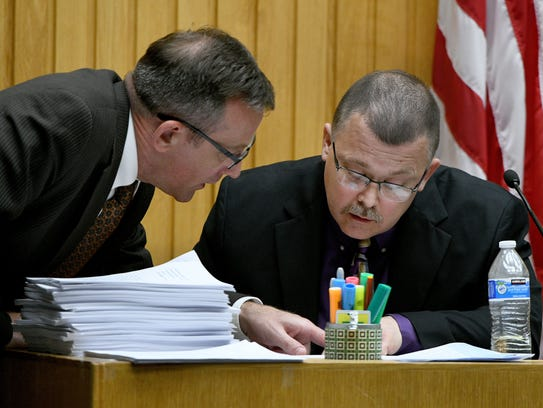 Defense attorney Wesley Stone goes over evidence with