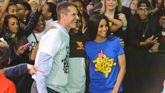 Michigan football coach Jim Harbaugh, left, First Lady Michelle Obama, center, and singer Ciara attend Citywide College Signing Day on May 1, 2015, in Detroit.