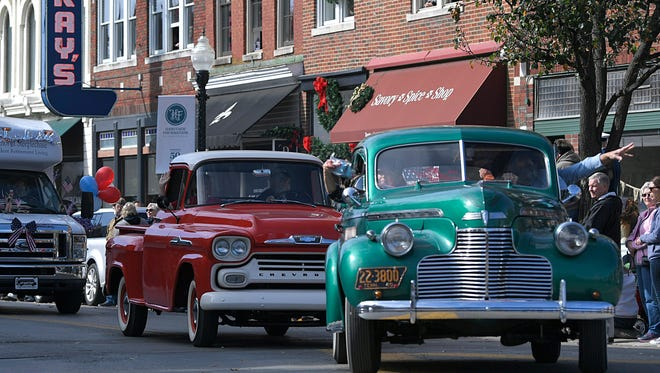 Antique cars drive in the Franklin Veterans Day Parade in downtown Franklin on Nov. 10, 2017. Williamson County has landed in the top 10 richest counties in the country, as ranked by Forbes magazine.