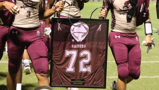 A ceremony honoring former Riverdale football player Zach Martin-Polsenberg took place before a game between Palmetto Ridge and Riverdale last season. His family walked with his teammates as they carried Zach's jersey in his memory. Zach died following a football practice.