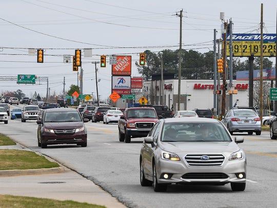 BART BOATWRIGHT/Staff Traffic on Woodruff Road is shown