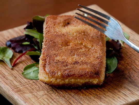 The smoked cheddar grit cake at Hammerheads is made