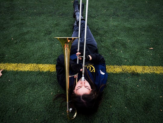 Trombonist Shannon Rossel warms up before rehearsal