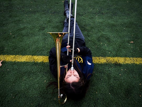Trombonist Shannon Rossel warms up before rehearsal with the Kutztown University Marching Unit at the Andre Reed Stadium on Kutztown University campus on Nov. 18.