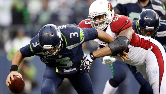 Cardinals defensive end Calais Campbell sacks Seahawks quarterback Russell Wilson in the fourth quarter on Dec 22, 2013, at in Seattle.