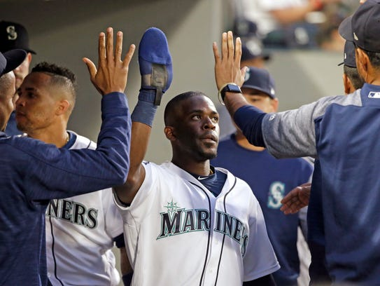 Seattle Mariners' Guillermo Heredia is congratulated