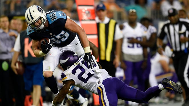 Titans tight end Chase Coffman (85) tries to power over Vikings cornerback Jabari Price (25) after making a catch during the fourth quarter at Nissan Stadium on Thursday in Nashville.