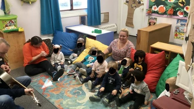 Abby Hodgkins of Growing by Leaps and Bounds child care in Burlington, with her young students.