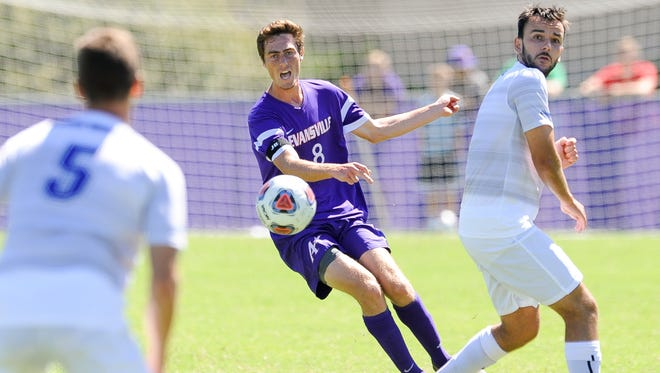 University of Evansville's Ian McGrath (8) kicks the ball away from Fort Wayne's Thilo Körperich (6)  during the ProRehab Aces Soccer Classic at Arad McCutchan Stadium, Sunday, Sept. 11, 2016. UE beat Fort Wayne 3-1.