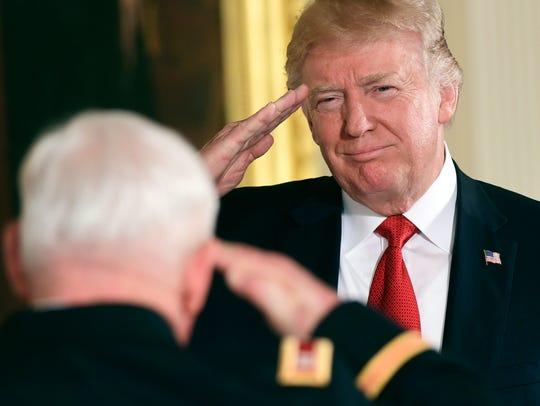 President Trump salutes retired Army Capt. Gary M.