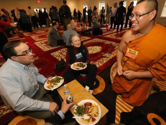 The Venerable Monk Preeda Momungkun, right talks with