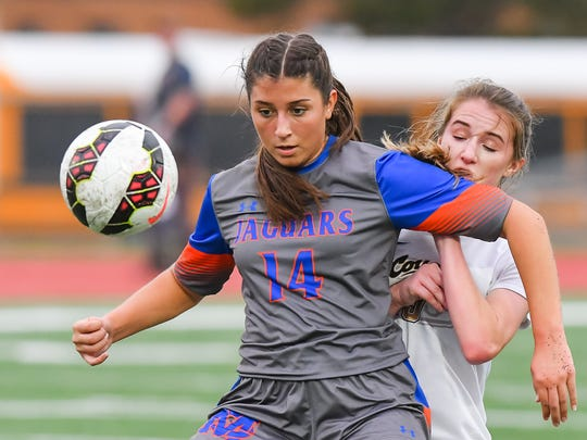 Madison Central's Audrey Eckerson (14) controls a ball