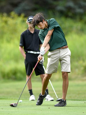 Perry's Nolan Hannan hits a tee shot with teammate Marshall Robbins watching during a match with Perry at The Sanctuary Golf Club, Aug. 19, 2020.