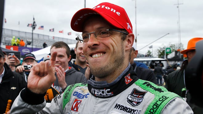 Sebastien Bourdais celebrates winning the second race of the IndyCar Detroit Grand Prix auto racing doubleheader, Sunday, May 31, 2015, in Detroit.