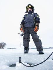 Tyler Kohl, 6, of Waukesha tries his luck ice fishing