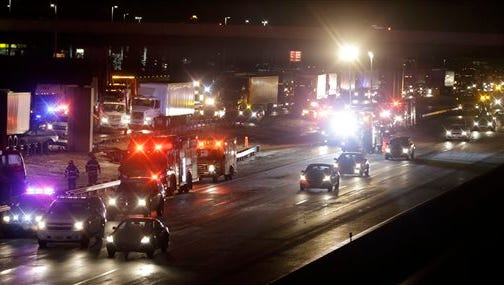 The scene of a multi-vehicle accident that closed the New Jersey Turnpike Monday near Cranbury. The highway pileup involving 15 or more vehicles including box trucks, tractor-trailers and a bus on Monday night left at least one person dead and several others injured.