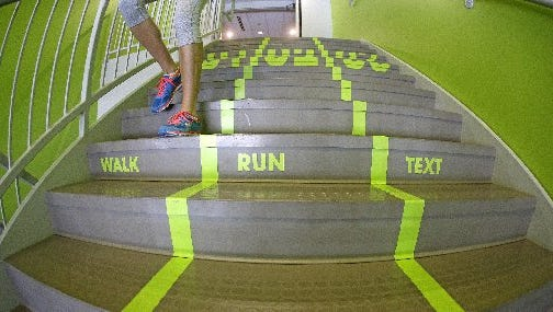 Stairs at one Utah college are divided for walkers, runners and texters.