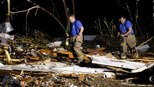 Emergency personnel search the remains of several mobile homes for survivors in Louisville, Miss., early Tuesday morning, April 29, 2014 after a tornado hit the east Mississippi community Monday.  Tornadoes flattened homes and businesses, flipped trucks over on highways and bent telephone poles into 45-degree angles as they barreled through Alabama and Mississippi on Monday, part of a storm system that killed at least nine people in the South and brought the overall death toll from two days of severe weather in the country to at least 26. (AP Photo/Rogelio V. Solis)