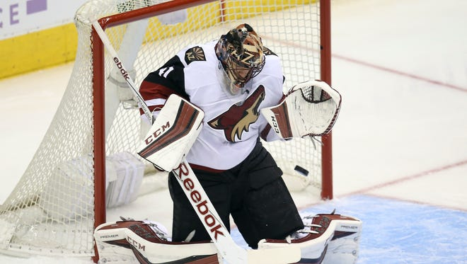 Arizona Coyotes goalie Mike Smith (41) makes a save against the Toronto Maple Leafs at Air Canada Centre. The Coyotes beat the Maple Leafs 4-3.
