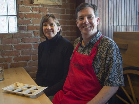 Alix and Toby Gadd pose for a photo at Nuance's retail store on Pine Street in Old Town on Friday, January 19, 2018. The bean-to-bar chocolate maker has become a Fort Collins staple, sharing rare flavors from around the globe.