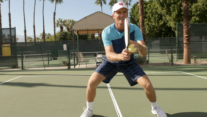 Marcin Rozpedski demonstrates proper pickleball form, keeping a low center of gravity at the Lakes Country Club in Palm Desert.