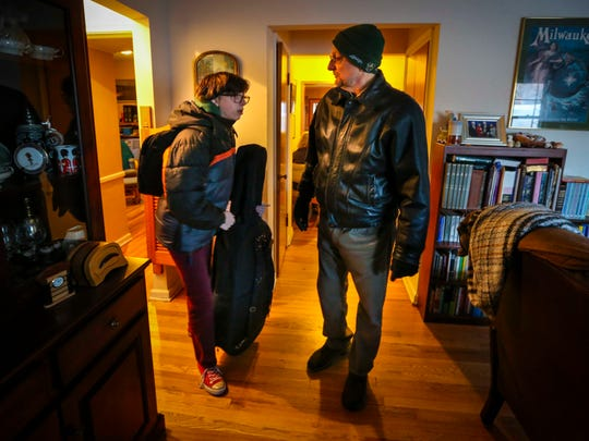 Bill Brauch and his daughter, Rachel, who attends Meredith Middle School, get ready to leave their west-side home for school at 7:15 a.m. Friday. Rachel often wakes as early as 6 a.m. to attend orchestra practice before school.