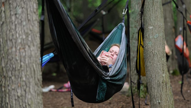 Emma Dowden of Memphis rests in the Hammock Hangout at the Firefly Music Festival.