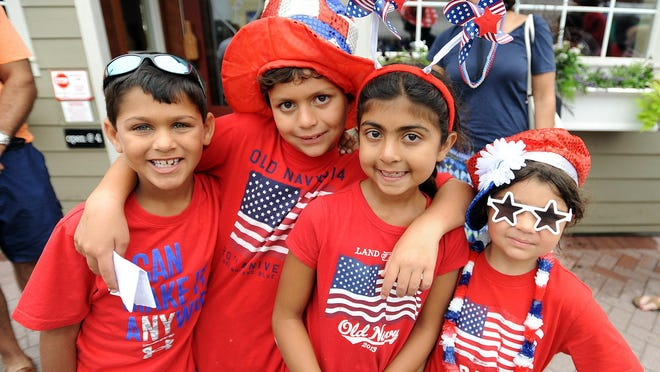 Layla and Devin Walke, ages 6 and 8, of Washington, D.C., hang with Riya Marnigi, 7, and Shaan Ailawadi, 7, of Philadelphia, on Saturday in Lewes.