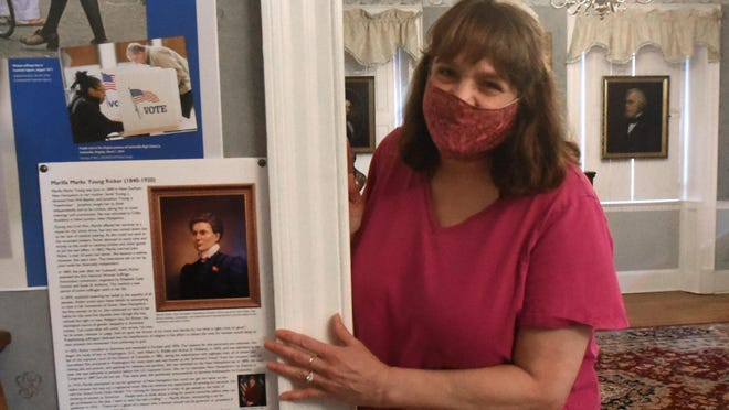 An exhibit about women sufferage, the 19th Amendment and life of Dover resident Marilla Ricker is now up at Dover's Woodman Institute Museum. Patricia Wilson points out things about Ricker's life, such as her trying to vote consistently for atleast 30 times but was always denied.