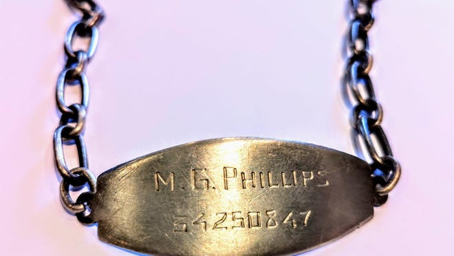 """The U.S. Army ID bracelet of """"M.G. Phillips,"""" found in the countryside of France in 2012, was reunited in September with the son of the soldier who wore it by Holland resident and genealogist Megan Heyl."""