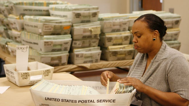 A worker sorts vote-by-mail ballots at the Riverside County registrar of voters office.