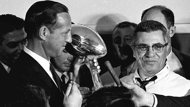 Football commissioner Pete Rozelle, left, presents the trophy to Green Bay Packers coach Vince Lombardi after they beat the Kansas City Chiefs 35-10 in Super Bowl I in Los Angeles.