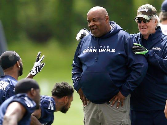FILE - Seahawks wide receivers coach Kippy Brown, left,