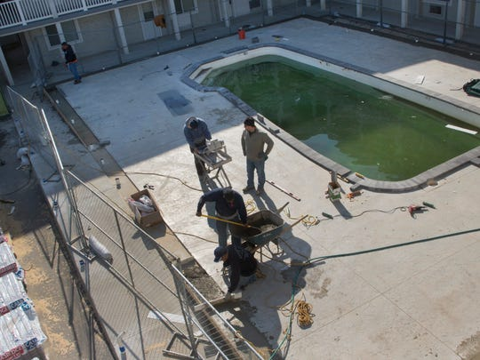 Workers spruce up the pool area of the Waldorf condominium complex in the Ortley Beach section of Toms River.