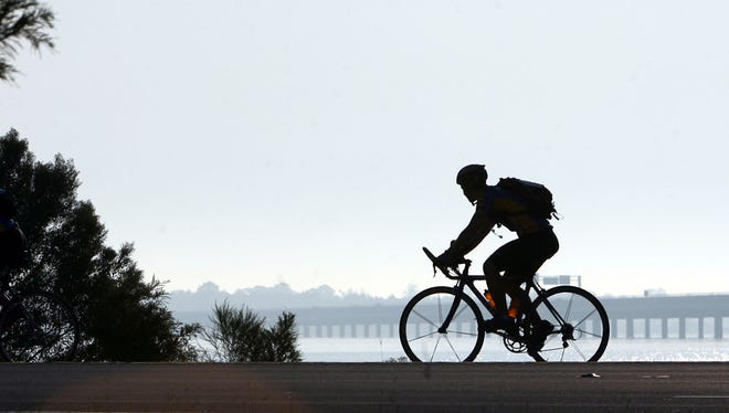 A lone biker makes his way toward Union Point and New Bern Riverfront Convention Center in New Bern, N.C.