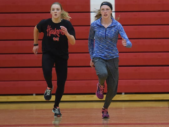 Brandon Valley's Tanya Tingle and Krista Bickley run