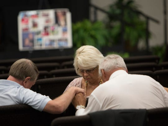 """Members of the First United Methodist Church in Punta Gorda pray before services for Mary Knowlton.  Knowlton was killed last Tuesday by a Punta Gorda Police officer in an accidental shooting during a """"shoot or don't shoot"""" scenario at the Punta Gorda Safety Complex."""
