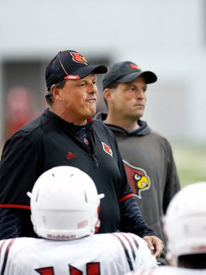 Louisville defensive coordinator Todd Grantham, left, and his brother, inside linebacker coach, Tony Grantham during practice on Wednesday afternoon.    April 6th, 2016