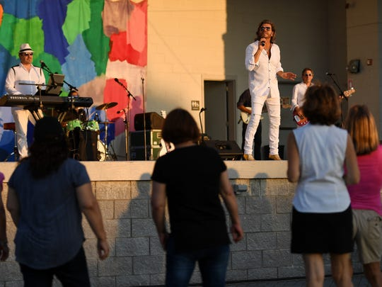 The New York Bee Gees perform at Overpeck County Park on Thursday, July 2, 2018.