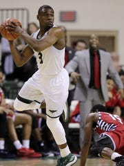 UWGB  guard Khalil Small (3)  was named to both the Horizon League's first team and all-defensive team on Wednesday.