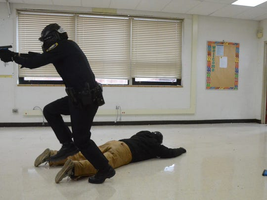 An officer engages bad guys during an active shooter training exercise Thursday.