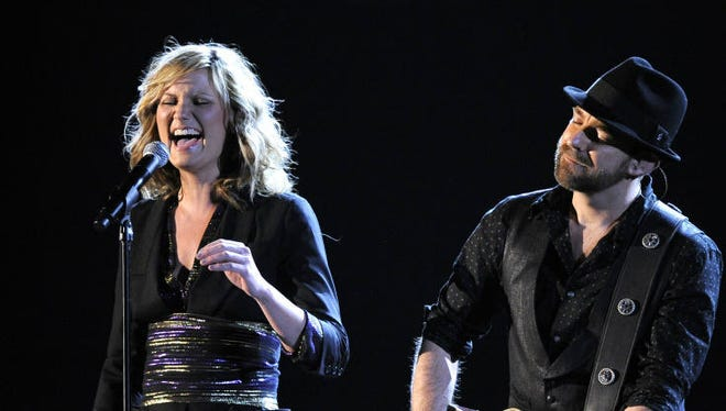 Jennifer Nettles, left, and Kristian Bush of Sugarland perform at the 51st Annual Grammy Awards on Sunday, Feb. 8, 2009, in Los Angeles. (AP Photo/Mark J. Terrill)
