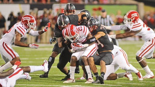 UL running back Raymond Calais Jr. is brought down during last year's 47-3 loss at Arkansas State. The Ragin' Cajuns and Red Wolves meet again Saturday night at Cajun Field.