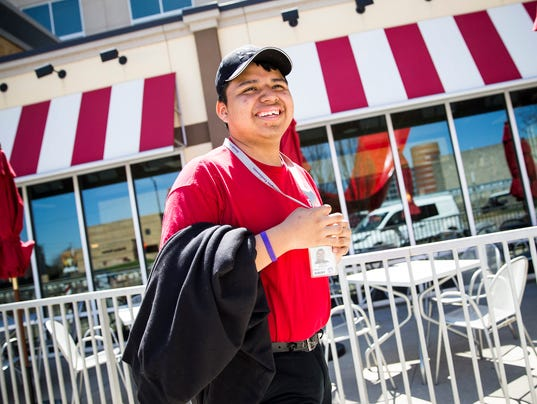 George Washington High School student, Armando Rodriguez, who has autism, spends part of his school day working at TGI Friday's in Indianapolis