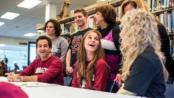 Enka senior Jasmine Palmer signed to play college softball for Florida State on Wednesday.