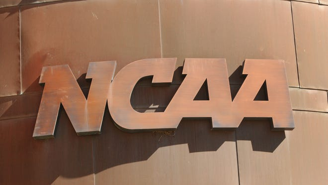 This logo is over the entrance to the NCAA headquarters, 700 W. Washington Street in Indianapolis.