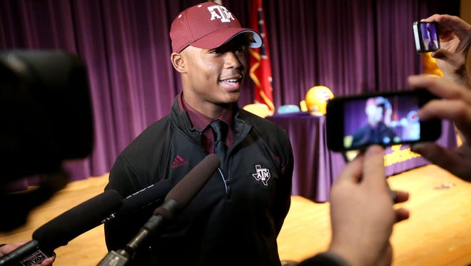 Smyrna's Ikenna Okeke is interviewed by the media after signing Texas A&M on National Signing Day on Wed. Feb. 3, 2016, during a ceremony at Smyrna High School.